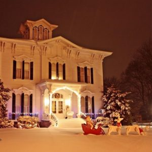 Tillinghast Manor Bed & Brunch front of the house in the snow with santa in the sleigh in the front yard