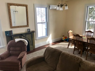 Photo of the Roosevelt Suite room with fireplace, couch and TV